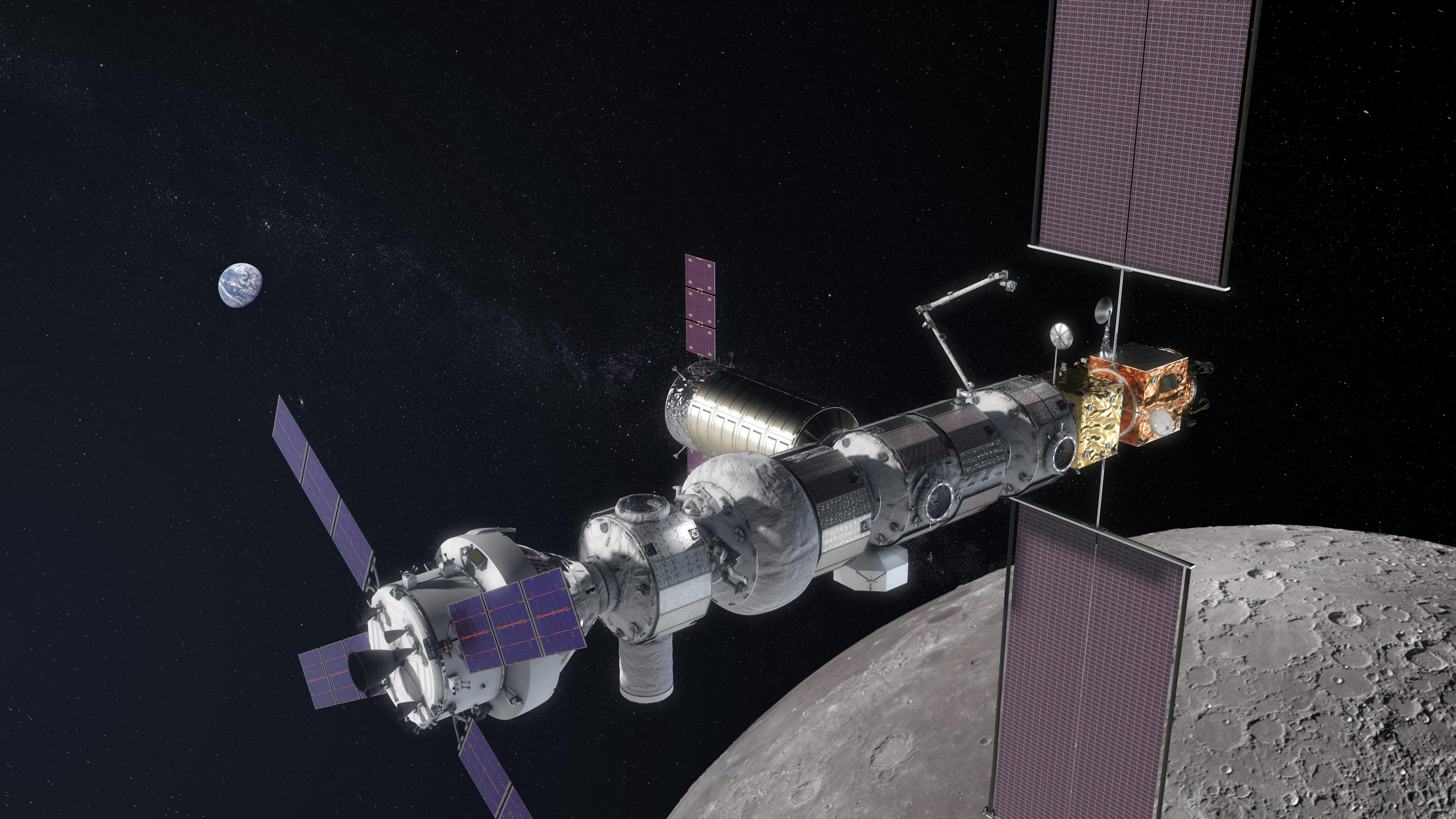 Slik kan the Gateway, den nye romstasjonen i bane rundt månen, komme til å se ut. Orion er dokket lengst til venstre. Illustrasjon: NASA