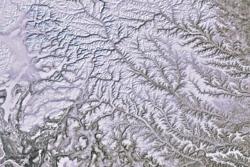 Snø i Sibir og elven Jenisej sett av Envisat i mars 2012. Foto: ESA