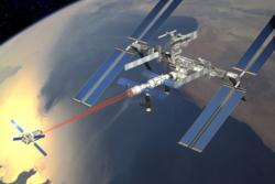 ATV dokker med romstasjonen vha lasere. Illustrasjon: ESA/D. Ducros