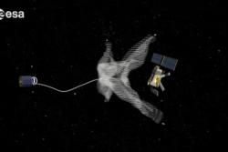 Konsept av romsøppelrydder. De store romorganisasjonene holder på å utvikle ny teknologi for å rydde romsøppel i bane. Illustrasjon: ESA