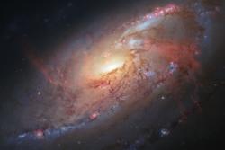 Galaksen M 106 sett av Hubble. Foto: NASA/ESA/R. Gendler