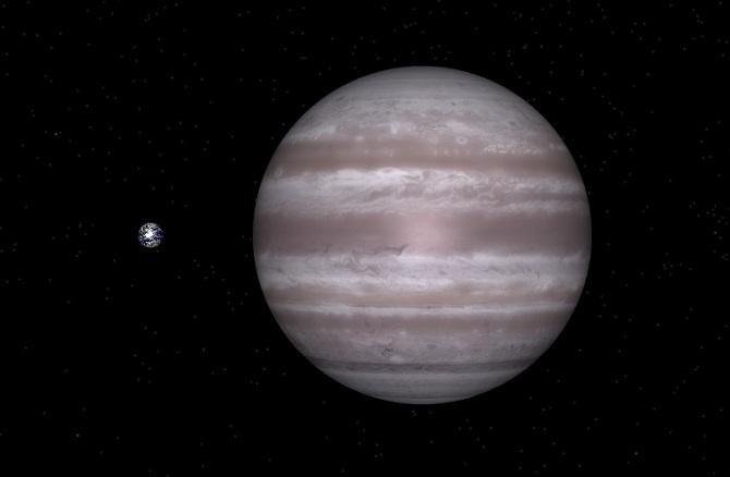 HD 68988 b sammenliknet med jorda (til venstre). Illustrasjon: NASA